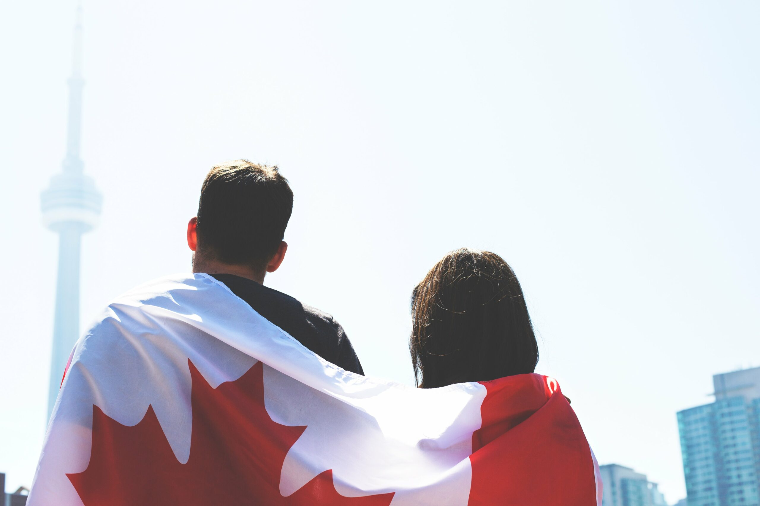 Canadian entrepreneurs with a Canadian flag wrapped around them