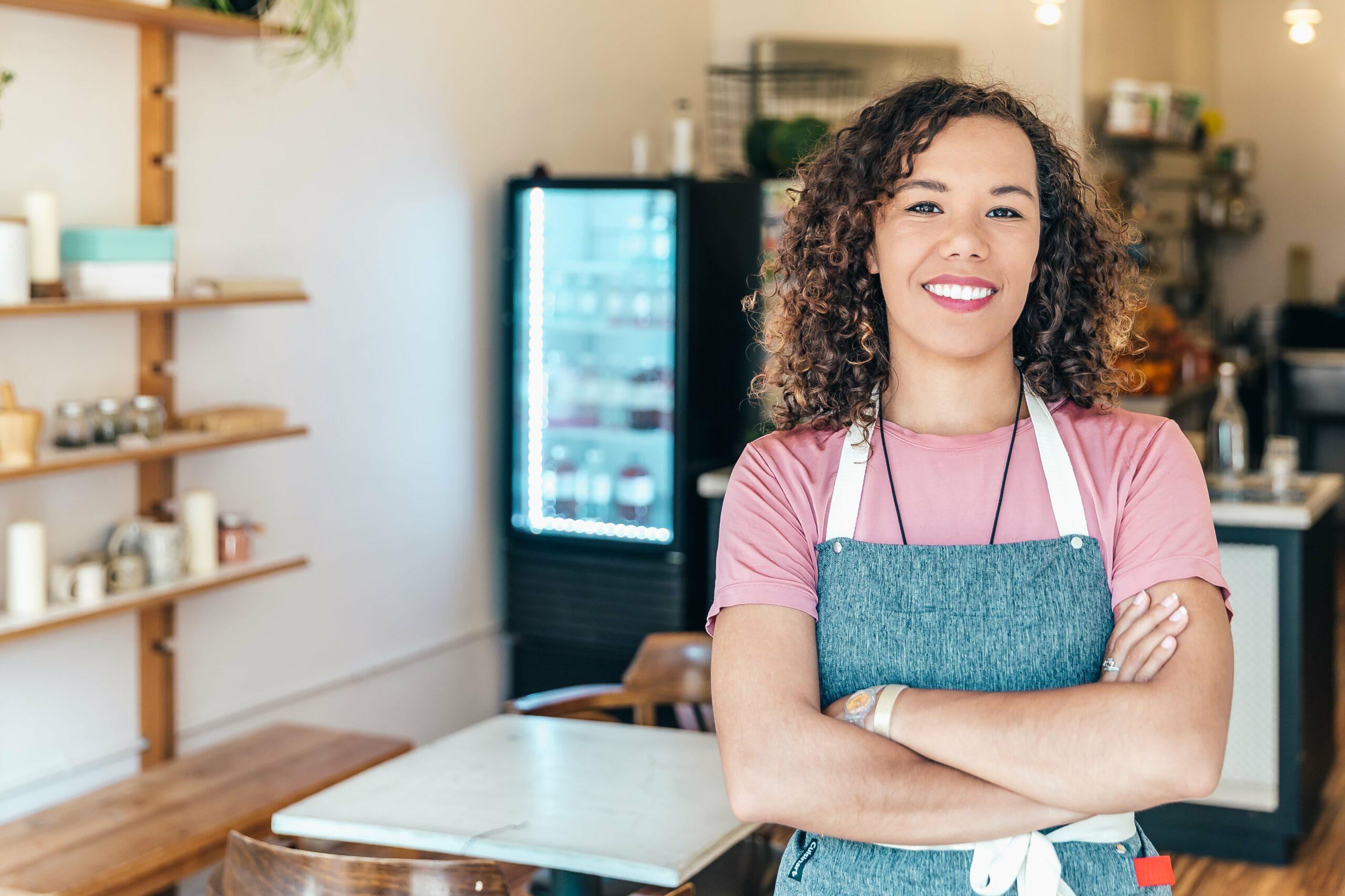 Canadian entrepreneur in a cafe smiling